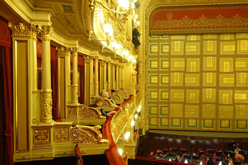 Prague National Theater patrons in the opera boxes.