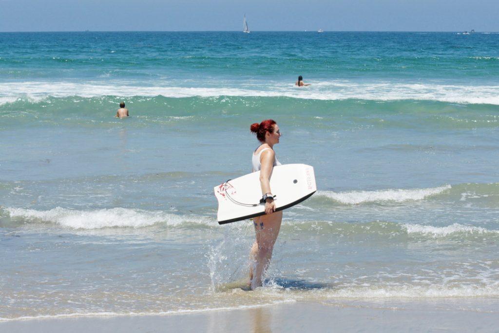 Bodyboard in the ocean.