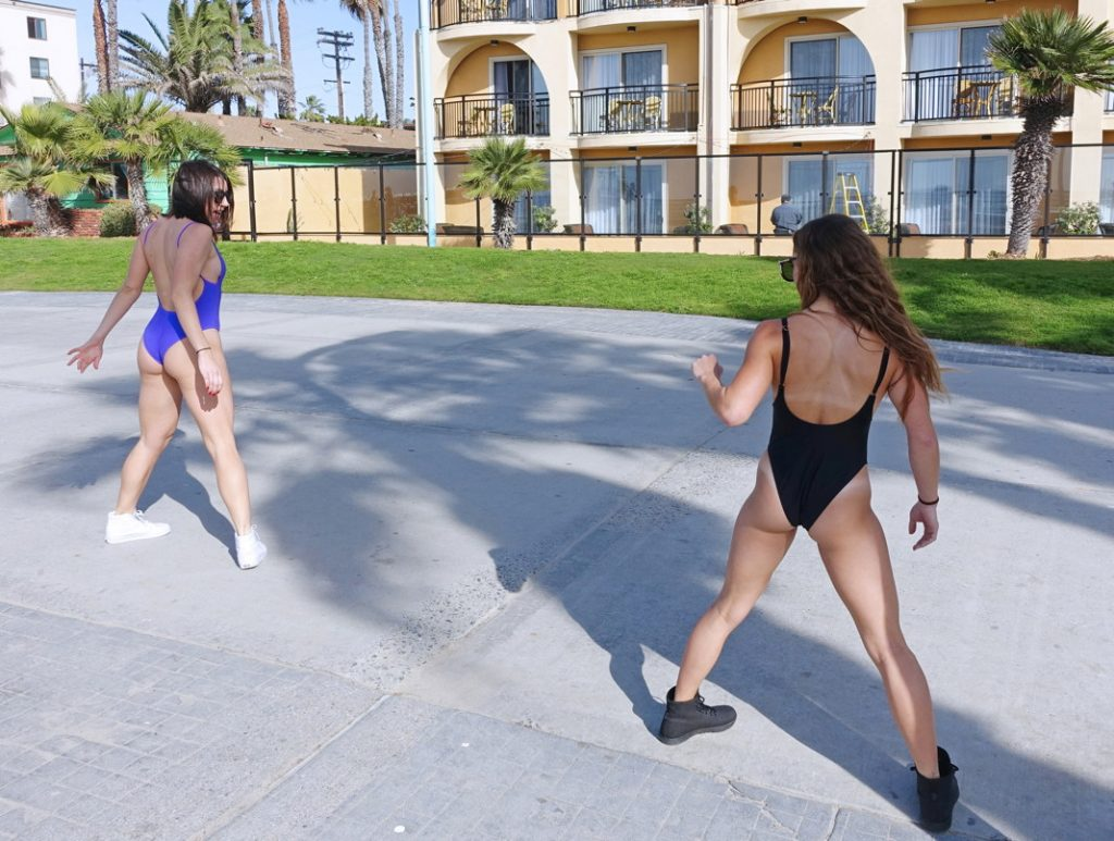 Dance with your friend on the boardwalk.