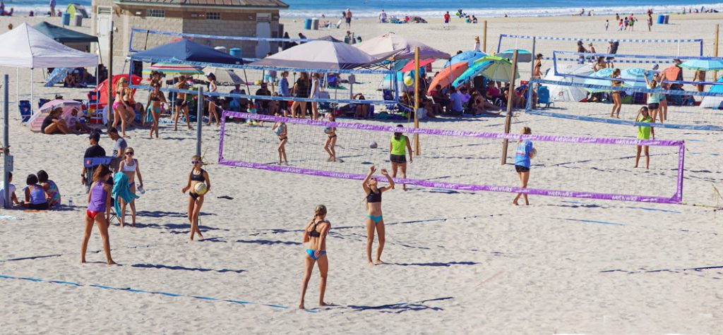 Play volleyball on a team.
