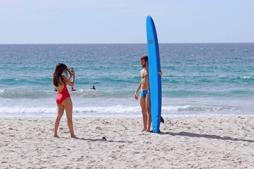 Pose with your surfboard.