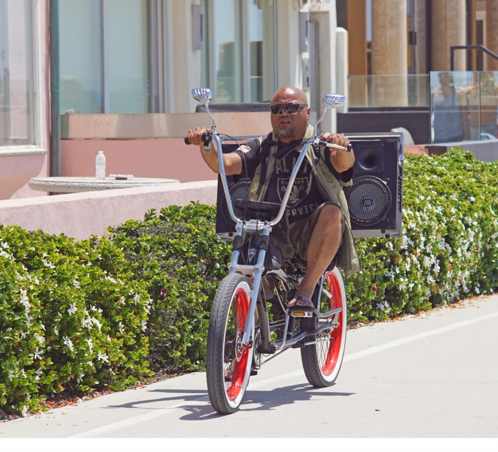 Ride a bike with a really big ghetto-blaster.