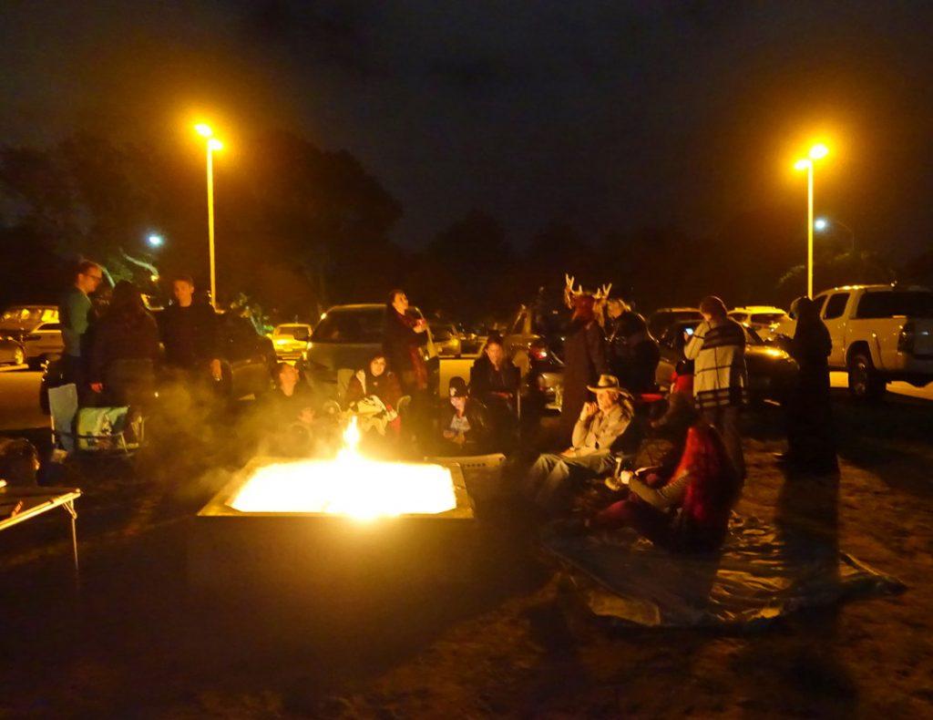 Stay warm at a beach bonfire.