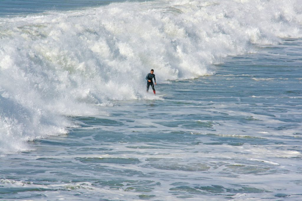 Surf in really big waves.