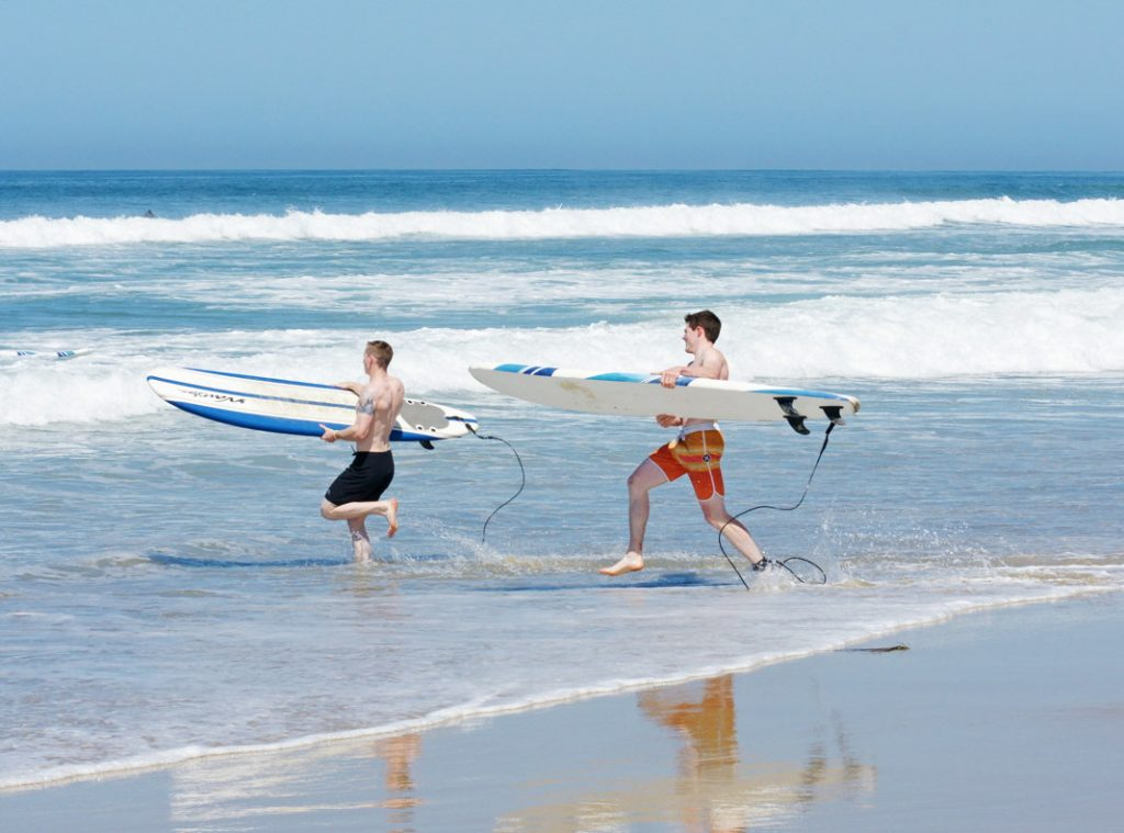 Surf with your friend.