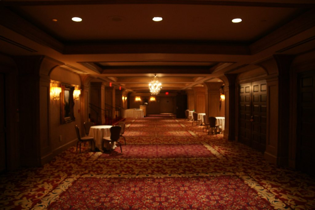Elegant hallway leading past conference rooms.