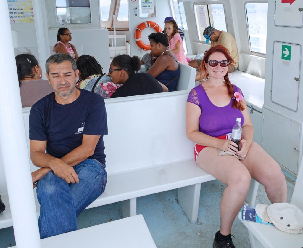 Happily riding with bored passengers on the ferry.