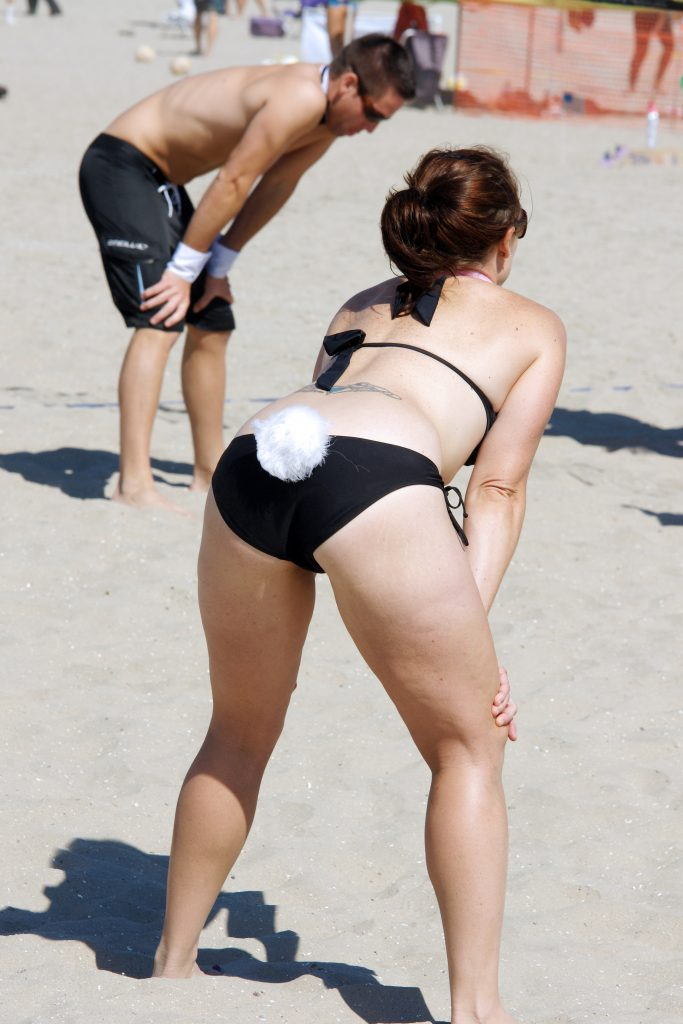 A volleyballer showing a little tail.