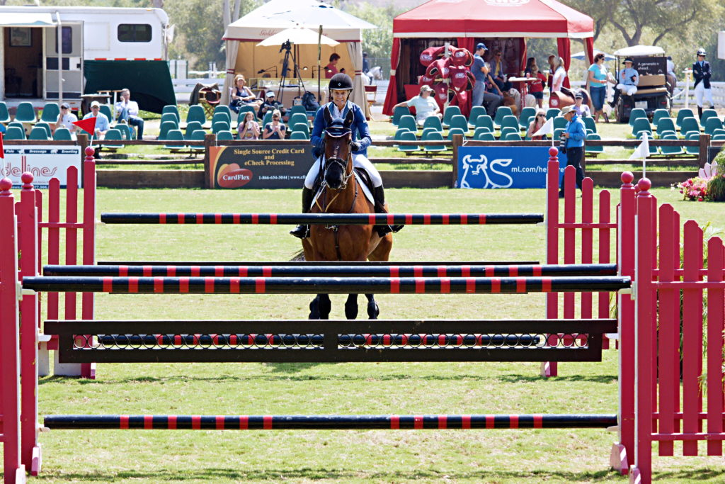 A rider approaches a combination jump.
