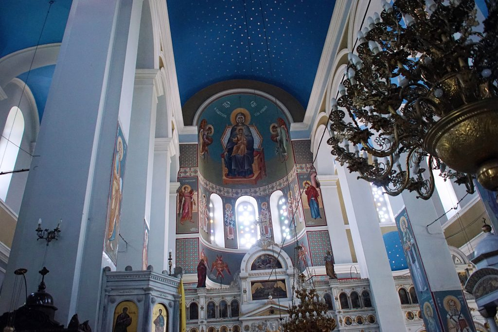The artwork above the altar depicts the Catholic god and his mother.