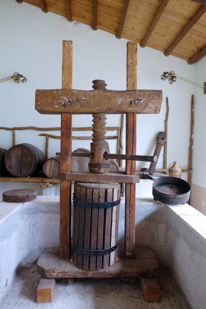 A human-powered wine press, making only a few liters at a time.