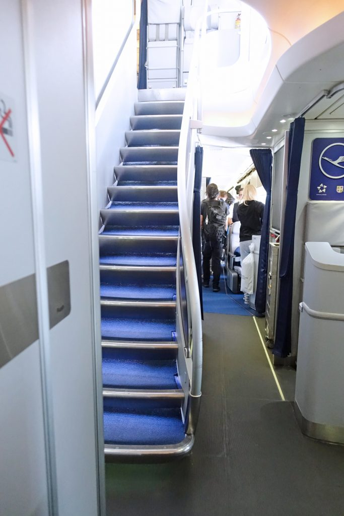 Up the stairs to the top deck of the aircraft.