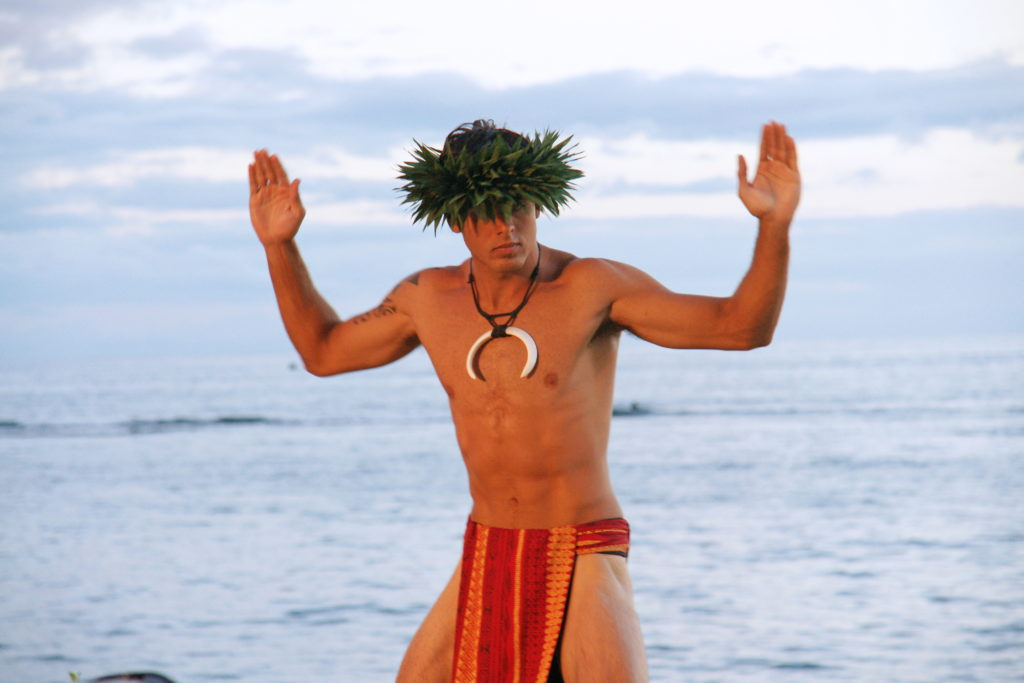 A dancer performs traditional Hawaiian dances.