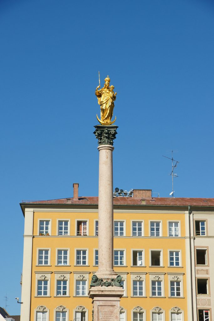 The Marian column is crowned by a gilt bronze statue of Christian's God's mom.