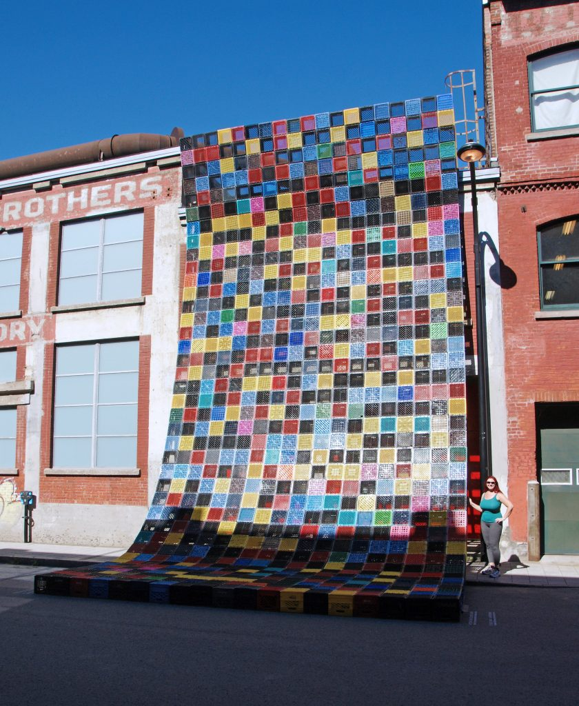A Canadian quilt shades a building.