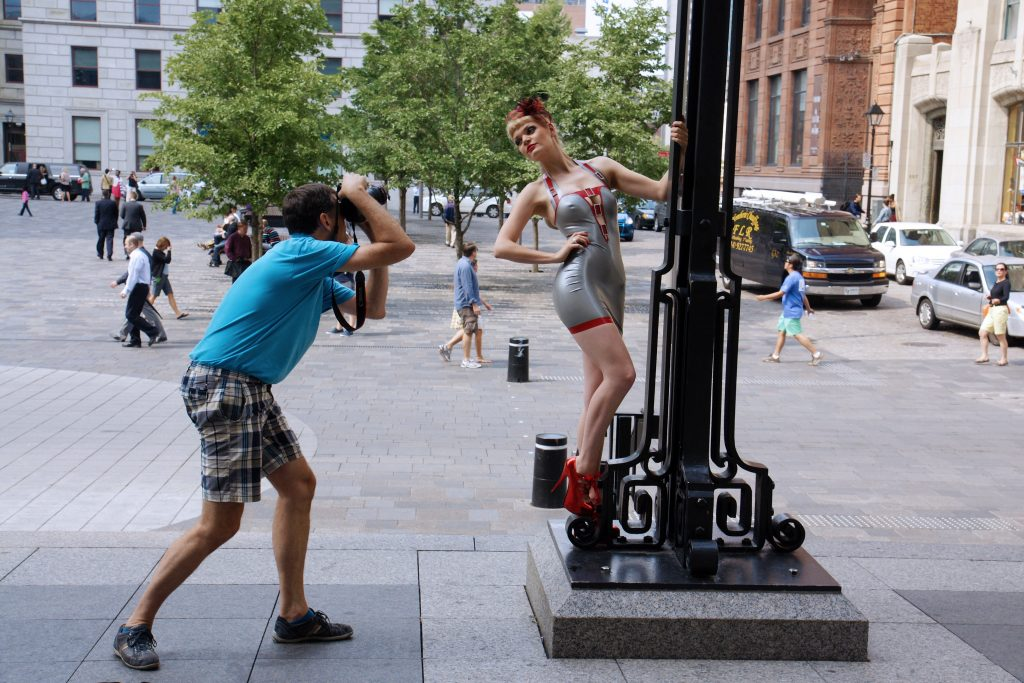 A Montreal lamp post fashion model hard at work.