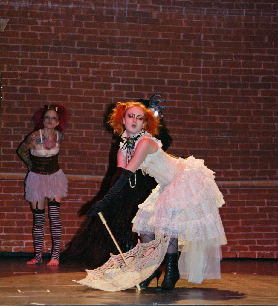 Steampunk performers performing.