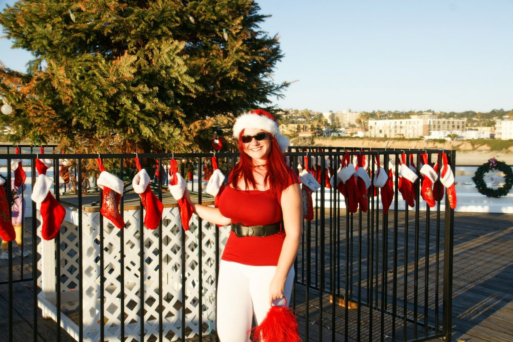 The stockings were hung on the gate surrounding the Christmas tree on Crystal Pier with care...