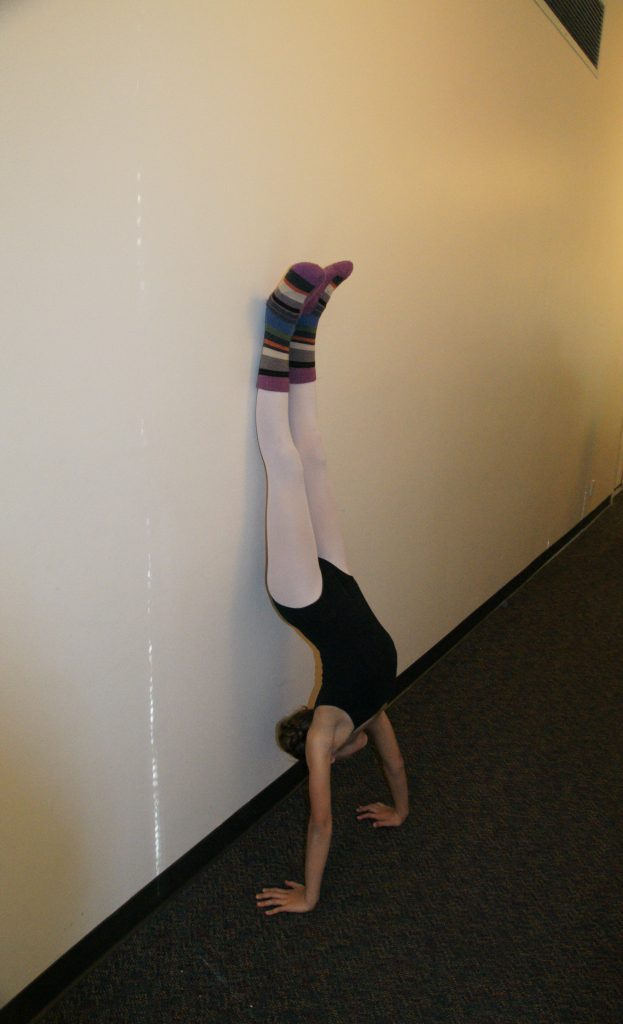 Nothing like a handstand to get a dancer warmed-up.
