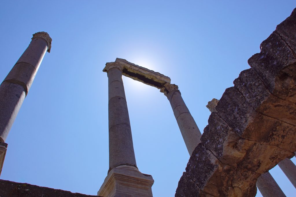 Mighy Helios, eclipsed by a marble ruin.