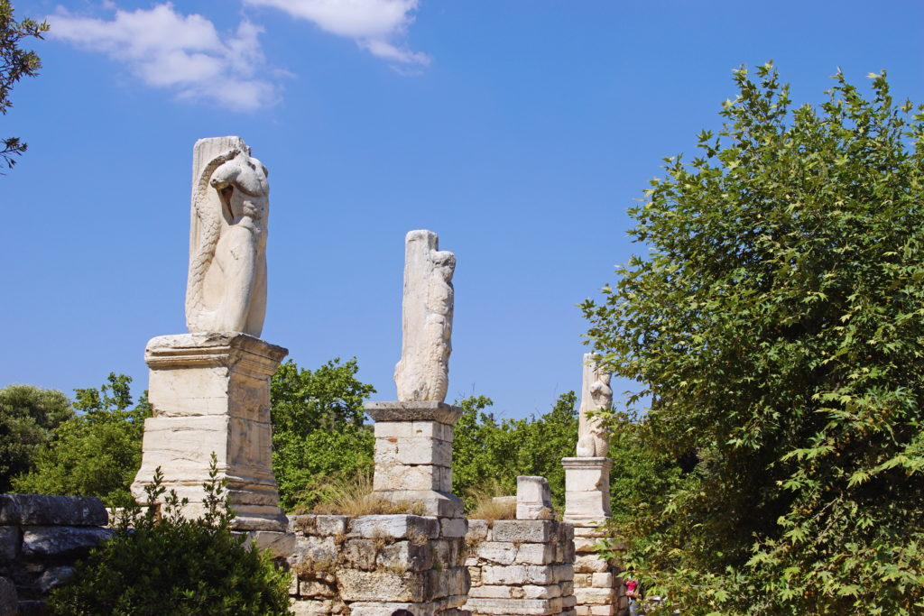 The statues of the Odeon of Agrippa greet us.