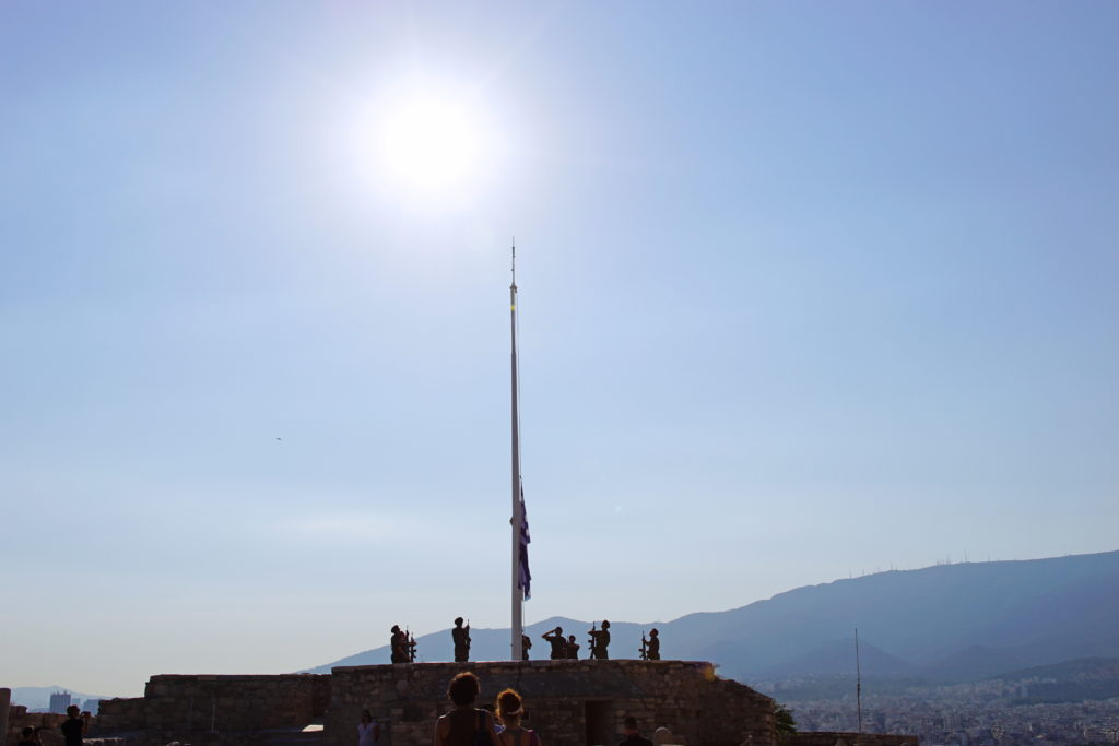Ever so slowly, the flag ascends the pole.