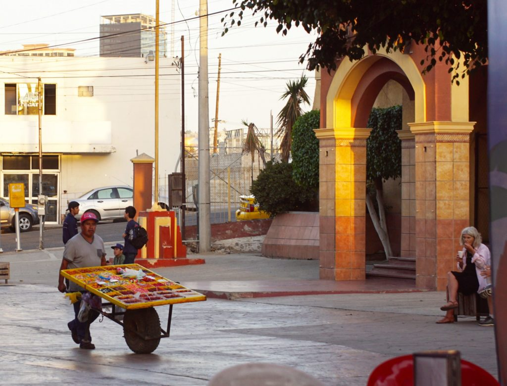 A street vendor vends on the street.