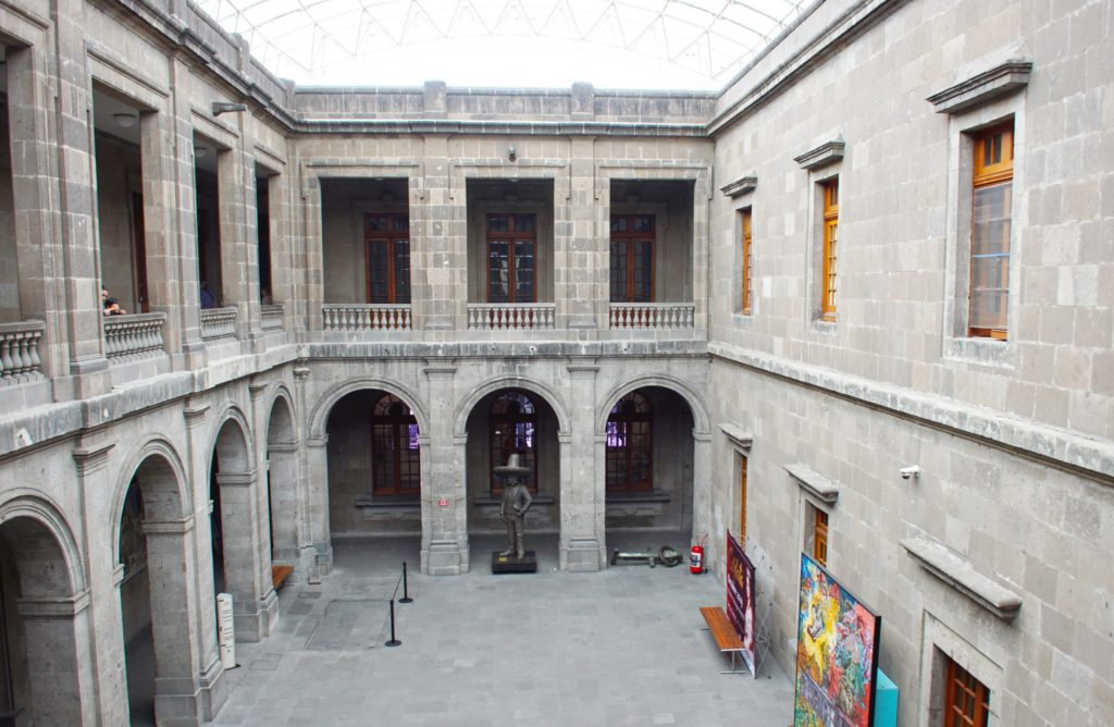 The inner courtyard, with a fire extinguisher and a thing on the ground.