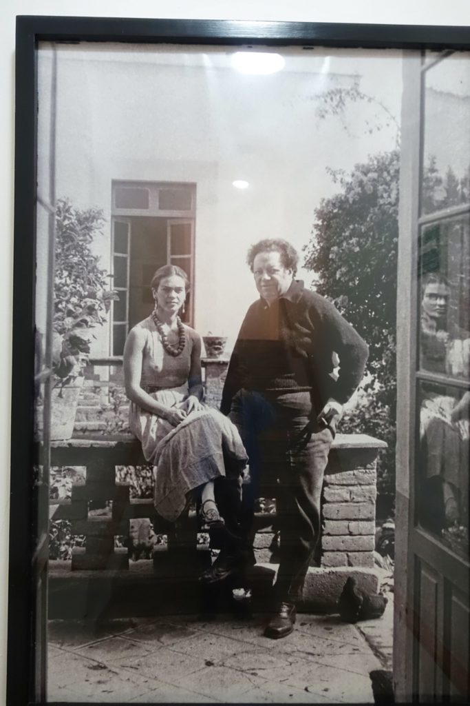 The two artists, casually posing in their garden.