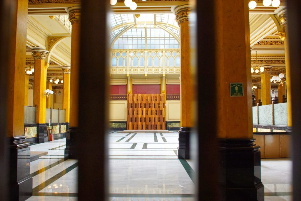 The main postal area, seen through the grating that protects it.