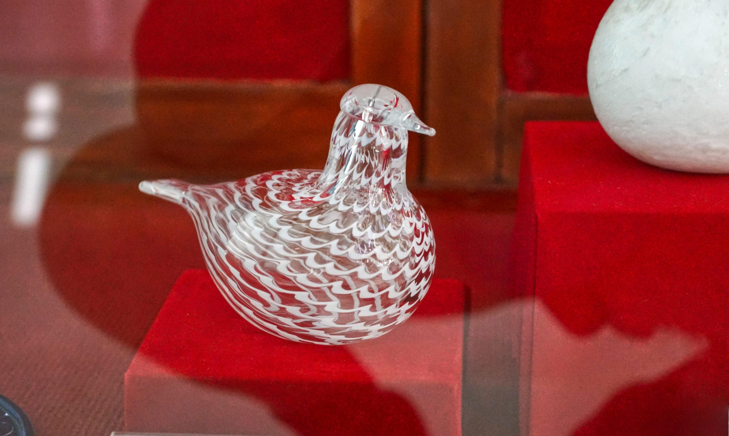Glass bird behind glass.