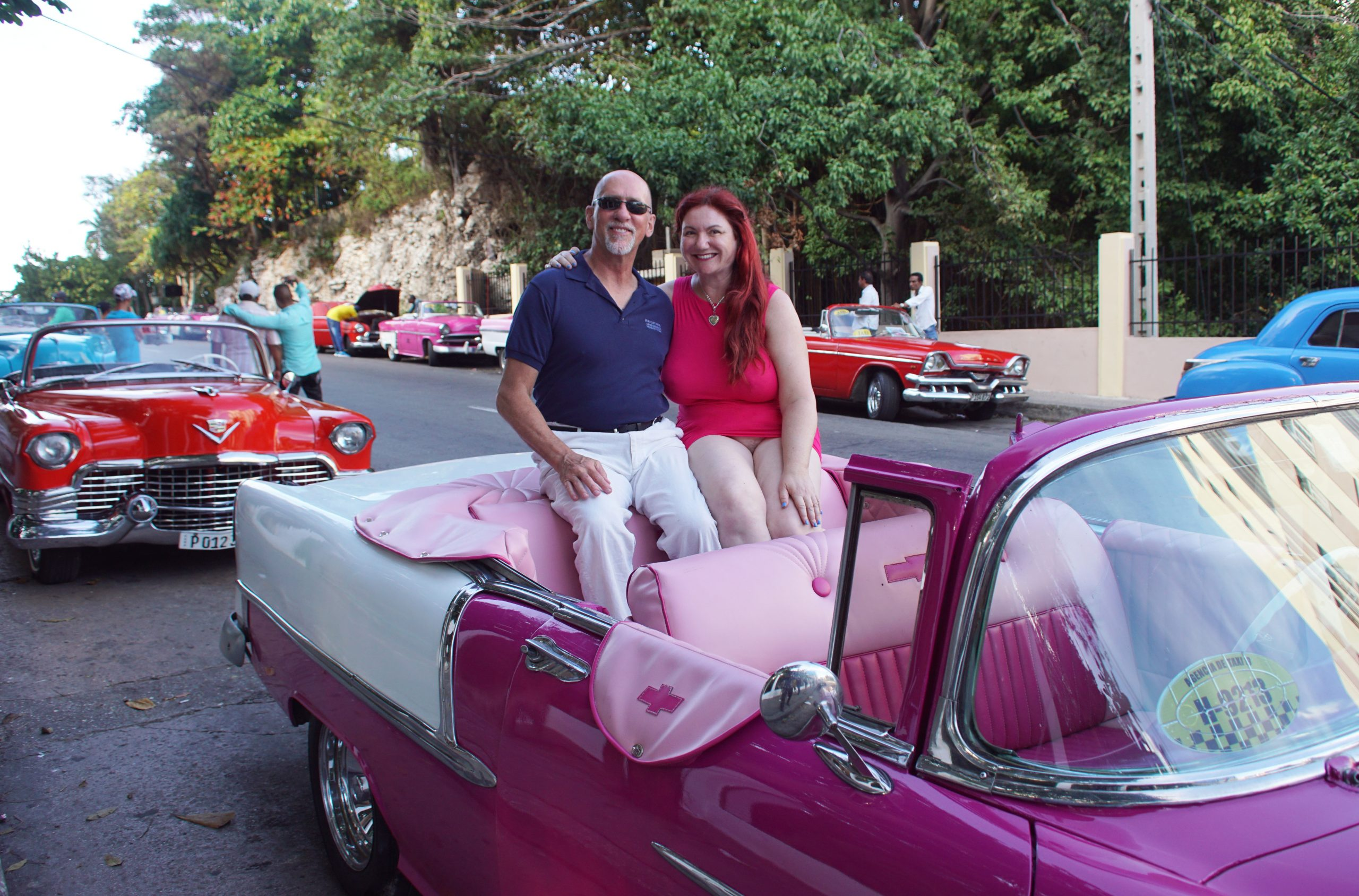Ready to ride in our pink classic 1955 Chevy convertible!