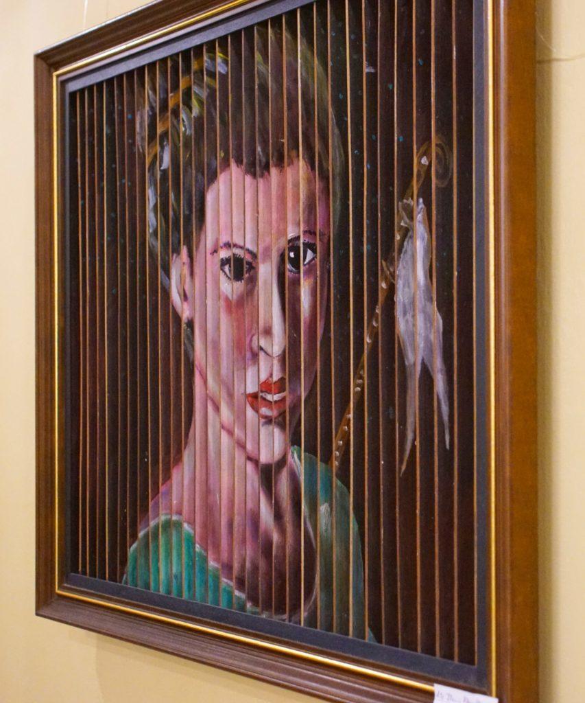 Portrait 1: Unhappy woman in green.