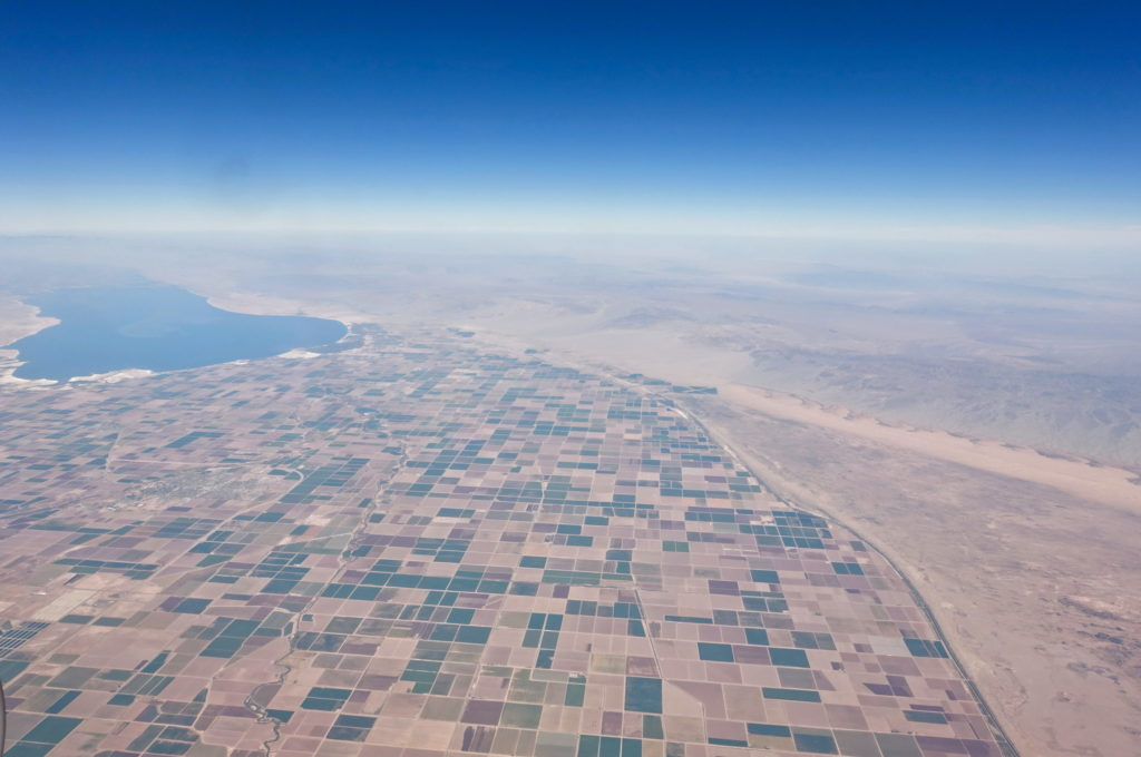 Somewhere in the desert, farmers are growing crops.