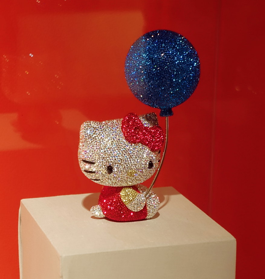 Jewel-encrusted Hello Kitty has a jewel-encrusted balloon.
